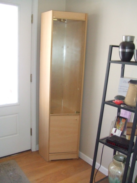 """Angled cabinet with shelves and bottom cabinet, lights matches smaller front mirror cabinet 16"""" deep by 15"""" wide, 6.1' high, glass door on upper, lower wood door. 3 glass shelves, bottom 2 shelves, $125.00"""