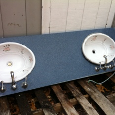 67 1/4 long by 22 wide, sinks are aprox 19.5 diameter by 16 They are porcelain with faucets The counter top is corian $400 (sinks are out of counter top)