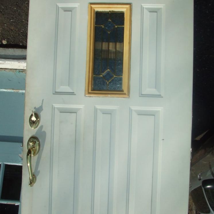Exterior metal door with leaded window - 36 x 80 Baldwin and Schlage hardware, kick plate $400
