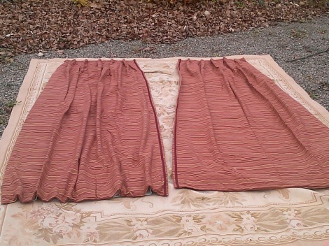 Rust drapes: there is one pair 2 panels curtains 92 x 70 (34 at top where it gathers) pinched pleats rust casual with casual orange pin stripes there is another pair 2 panels 92 x 45 (25 at top at the top where is gathers) Matching sets $300 for all (used for 6 months paid $1,500) Wrinkles may be steamed out
