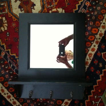 mirror with hooks $125